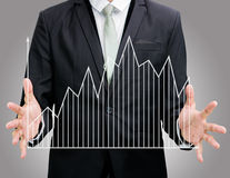 Businessman standing posture hand holding graph finance isolated Stock Photo