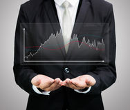 Businessman standing posture hand holding graph finance isolated Royalty Free Stock Images