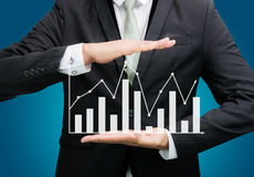 Businessman standing posture hand holding graph finance  Stock Photography