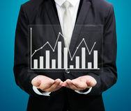 Businessman standing posture hand holding graph finance  Royalty Free Stock Photography