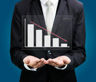 Businessman standing posture hand holding graph finance  Royalty Free Stock Photo
