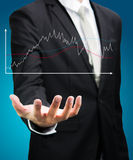 Businessman standing posture hand holding graph finance  Royalty Free Stock Image