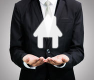 Businessman standing posture hand holding house icon isolated. On over blue background stock photos
