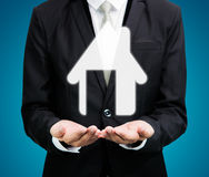 Businessman standing posture hand holding house icon. On over blue background royalty free stock image
