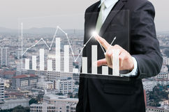 Businessman standing posture hand touch graph finance Stock Photos