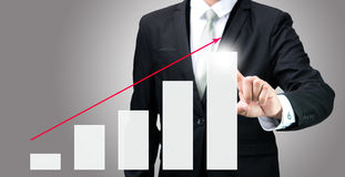 Businessman standing posture hand touch graph finance isolated Stock Image