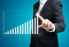 Businessman standing posture hand touch graph finance isolated Royalty Free Stock Image