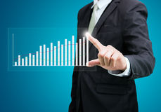 Businessman standing posture hand touch graph finance  Royalty Free Stock Image