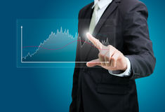 Businessman standing posture hand touch graph finance  Royalty Free Stock Images