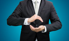 Businessman standing posture show hand. On over blue background Royalty Free Stock Images