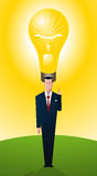 Businessman standing proud with bright idea Royalty Free Stock Images