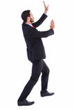 Businessman standing and pushing up Royalty Free Stock Photo