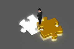 Businessman standing on puzzle watching hole Royalty Free Stock Images