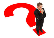 Businessman standing on question mark Stock Images