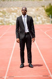 Businessman standing on a racing track Stock Image