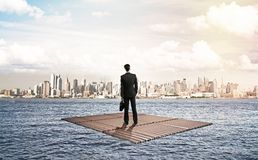 Businessman standing on raft Royalty Free Stock Photo