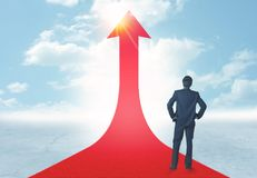 Businessman standing on a red arrow Stock Images
