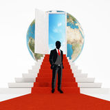 Businessman standing on the red carpet leading to the open door. 3D illustration Royalty Free Stock Photo