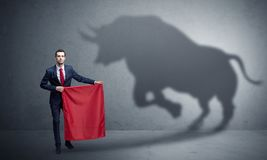 Businessman with bull shadow and toreador concept royalty free stock photo