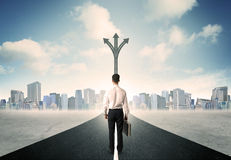 Businessman standing on the road. Concept of the road to success with a businessman standing on the road Stock Photo