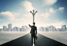 Businessman standing on the road Royalty Free Stock Photos