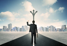 Businessman standing on the road Stock Photos