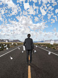 Businessman standing on road Stock Photography