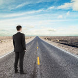 Businessman standing on road Royalty Free Stock Photo