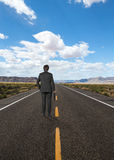 Businessman standing on road Stock Images
