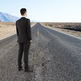 Businessman standing on road Stock Image