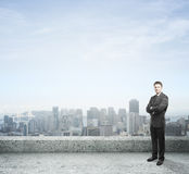 Businessman standing on roof Stock Photography