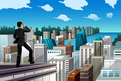 Businessman standing on a rooftop Royalty Free Stock Images
