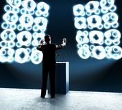 Businessman standing on rostrum Royalty Free Stock Photo