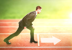 Businessman standing on running track royalty free stock photography