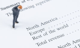 Businessman standing on the sale region report Stock Images