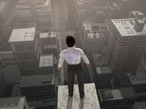 Businessman standing on the skyscraper top Royalty Free Stock Image