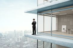 Businessman standing on skyscrapper Royalty Free Stock Photos