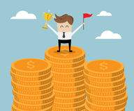 Businessman Standing on Stack of Gold Coin with Trophy and Red F Stock Images
