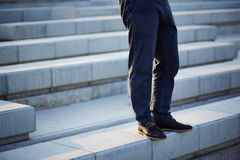 Businessman standing in stairs Royalty Free Stock Images