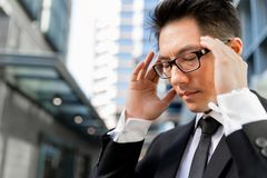 I need to concentrate. Businessman standing in street and trying to concentrate Stock Photos