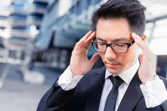 I need to concentrate. Businessman standing in street and trying to concentrate Stock Images