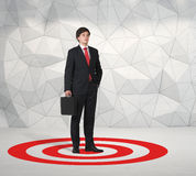 Businessman standing on target Royalty Free Stock Photo