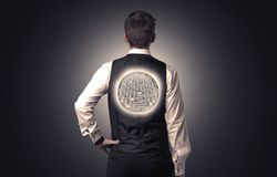 Businessman standing with maze on his back Stock Photos