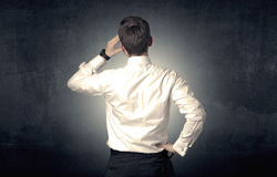 Businessman standing and thinking Royalty Free Stock Photo