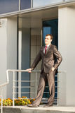 Businessman standing on the threshold Stock Images