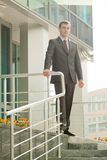 Businessman standing on the threshold Stock Photo