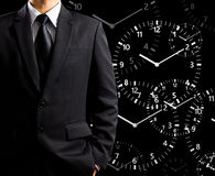Businessman standing and times Stock Photography