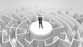 Businessman standing on the top of a maze stock photos