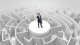 Businessman standing on the top of a maze stock photography