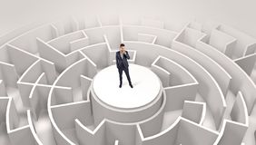Businessman standing on the top of a maze stock image